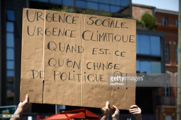 Placard reading 'Social urgency climatic urgency When will we change of policy ' A quotmaree populairequot demonstration was called by more than 60...