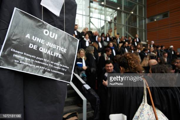 Placard reading 'Yes to a justice for all' Lawyers counsels and magistrates gathered in front of the Toulouse' courthouse for a day called 'Dead...