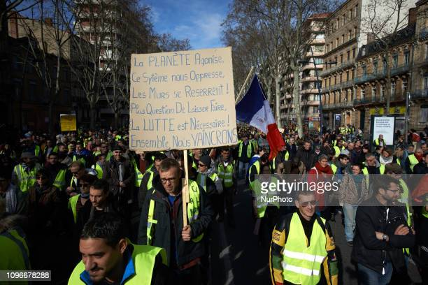 A placard reads 'Earth is dying this system is oppressive no question to keep it up fight is vital together we will win' Act XIII dubbed 'Civil...