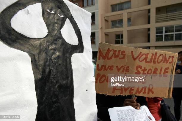 A placard reads 'We want a steady life for our future' near a drawing made by a minor and depicting himself Unaccompanied foreign minors gathered in...