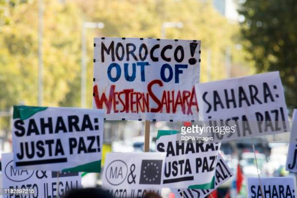 Placard saying, Morocco out of Western Sahara during the demonstration. Thousands of Saharawis arrive from all over Spain to demand the end of...