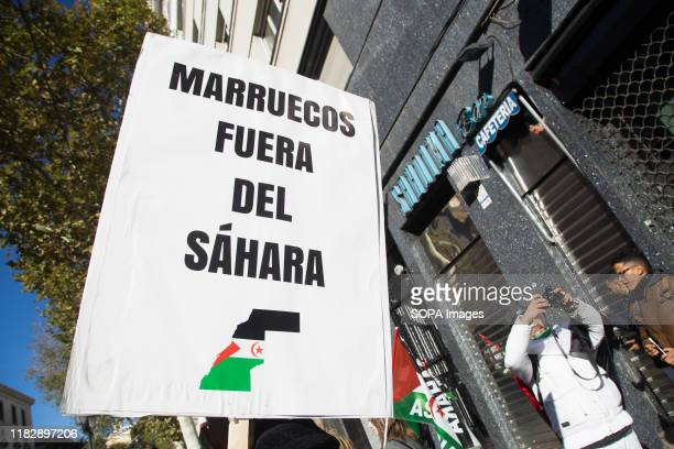 Placard saying, Morocco outside Western Sahara, during the demonstration. Thousands of Saharawis arrive from all over Spain to demand the end of...