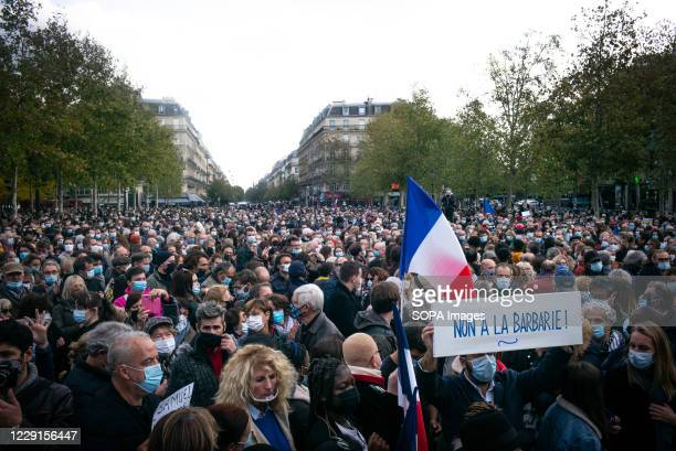 Placard saying 'No to Brutality' during the tribute. Thousands gathered at the Place de la Republique to protest and pay tribute to 47-year-old...