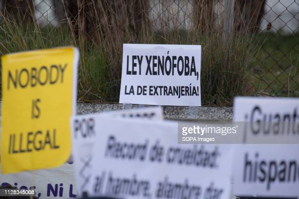 A placard seen accusing the Spanish Immigration Law of being xenophobic during the protest Feminist movement protest as a preparatory action for the...