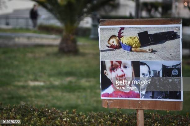 A placard showing dead children seen at the demonstration Kurds living in Athens marched toward the Turkish embassy the protest against the genocide...
