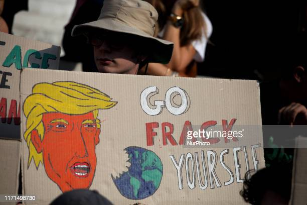 A placard showing the President of the US Donald Trump as students and environmental organisations hold placards during a rally in front of the Greek...