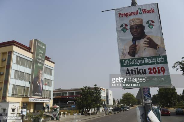 A placard shows main opposition PDP party presidential candidate Atiku Abubakar along a road at the campaign headquarters of Peoples Democratic Party...