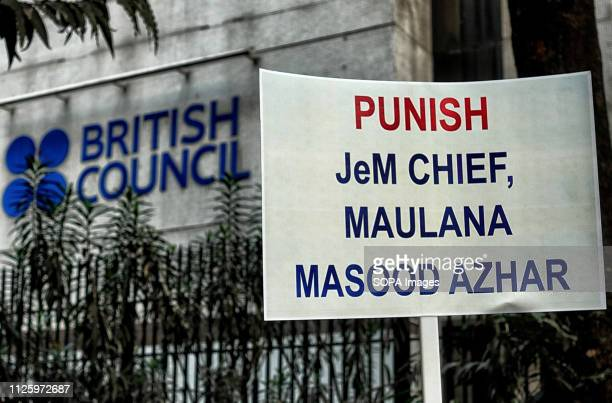 A placard that says 'Punish JeM Chief Maulana Masood Azhar' seen in front of the British Council UNICEF West Bengal Office with a demand to declare...