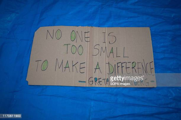 A placard with a phrase of environmental activist Greta Thunberg laying on the ground during the protest Members of 'Malaga's alliance for the...