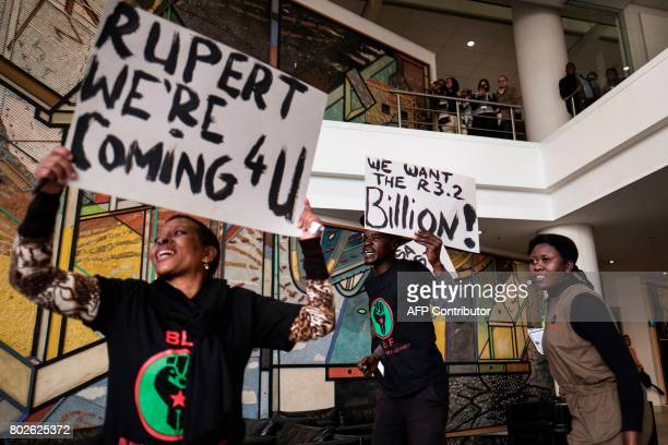 A placard with a slogan against Johann Rupert the heir of South African business tycoon Anton Rupert the chairman of the Swissbased luxurygoods...