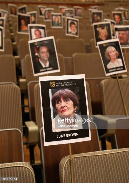 Placard with soap actress June Brown on sits with others symbolizing guests as part of preparations for the upcoming British Academy Television...