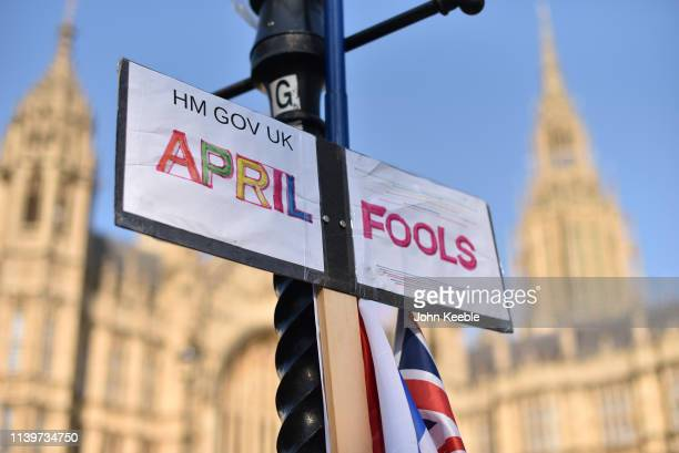 "Placard with the words ""HM Gov UK April Fools"" leans against a lamp post outside the Houses of Parliament on April 01, 2019 in London, England. MPs..."