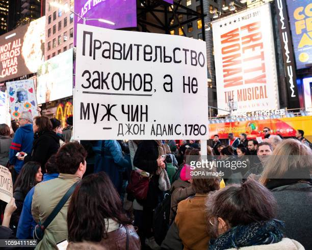 A placard written in RUssian language seen during the rally Thousands took to Times Square of New York City during a rally to support Robert...