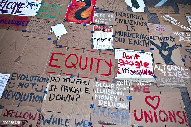 Placards against the economic system are left in Zuccotti Park where protestors demonstrate against the economic system in Lower Manhattan on Monday,...
