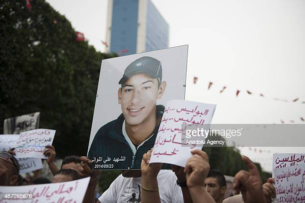 Placards against the police torture are seen as twentyseven grassroot organizations demand justice for Mohamed Ali Snoussi and Ali Ben Khemaies...