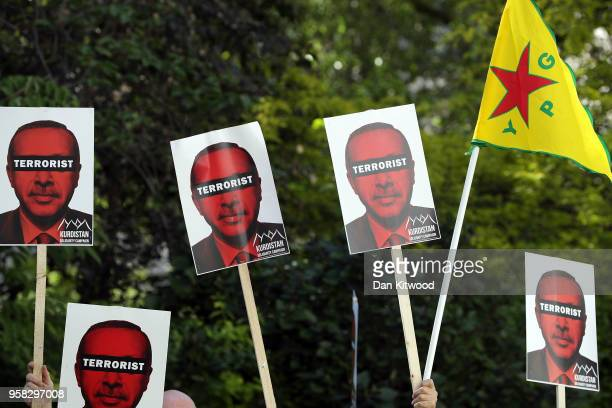 Placards are held aloft as antiErdogan protesters gather outside Chatham House ahead of a visit by the Turkish President Recep Tayyip Erdogan on May...