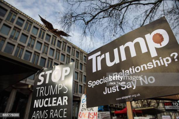 Placards are held outside the US Embassy during a demonstration against US President Donald Trump on February 4 2017 in London England Thousands of...