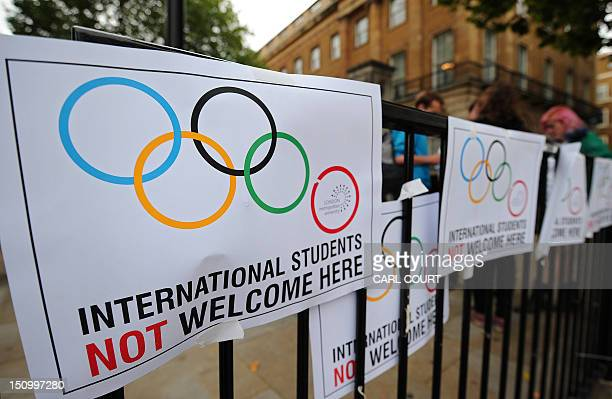 Placards are pictured during a demonstration outside 10 Downing Street in London on August 30 against the British governments decision to strip the...