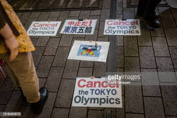 Placards are pictured during a protest against the Tokyo Olympics on May 17, 2021 in Tokyo, Japan. With less than 3 months remaining until the Tokyo...