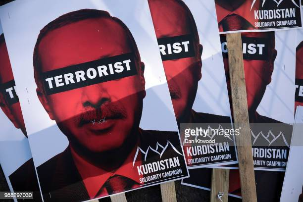 Placards are seen belonging to antiErdogan protesters gathered outside Chatham House ahead of a visit by the Turkish President Recep Tayyip Erdogan...