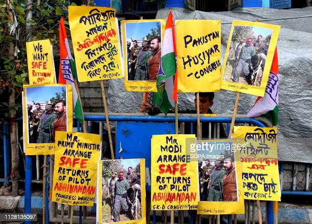 Placards are seen hanging at the traffic police gate during the protest against Pakistan and demand for a safe return of the Indian air force Pilot...