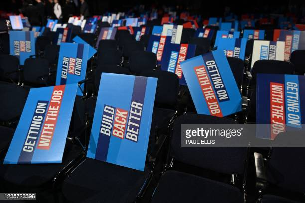 Placards are seen on seats in the main auditorium on the final day of the annual Conservative Party Conference at the Manchester Central convention...