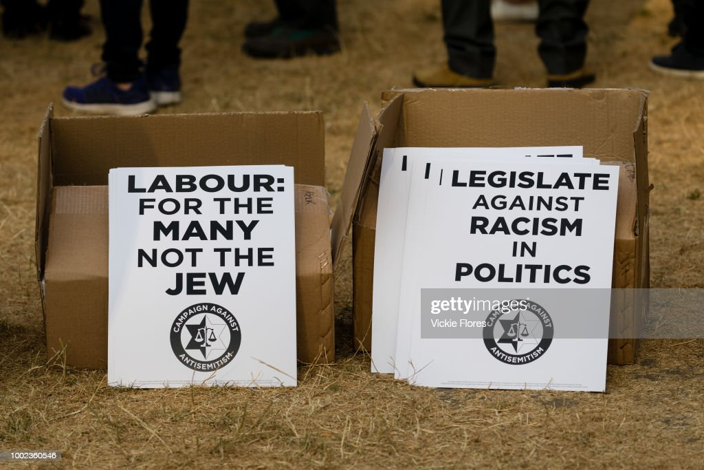 Placards are seen on the ground as the campaign group, Campaign Against Antisemitism, Jewish community groups and their supporters stage a protest in Parliament Square, London, England on July 19, 2018 against the Labour Party anti-semitism code following the partys announcement that it will take action against Dame Margaret Hodge MP for calling Jeremy Corbyn an antisemite.