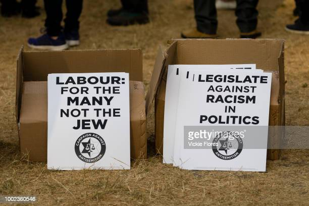 Placards are seen on the ground as the campaign group Campaign Against Antisemitism Jewish community groups and their supporters stage a protest in...