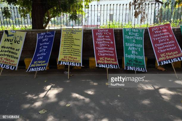 Placards criticizing actions of the Jawaharlal Nehru University Vice Chancellor Jagadesh Kumar lie alongside a road where JNU students gather to...