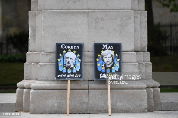 TOPSHOT Placards featuring Britain's opposition Labour party leader Jeremy Corbyn and Britain's Prime Minister Theresa May in the colours of the EU...