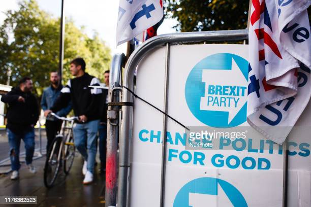 Placards for the Brexit Party stand fixed to railings on Abingdon Street outside the Houses of Parliament in London England on October 17 2019 Prime...
