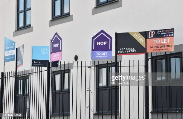Placards from various estates agents advertising new properties To Let on May 27, 2021 in Leeds, England.