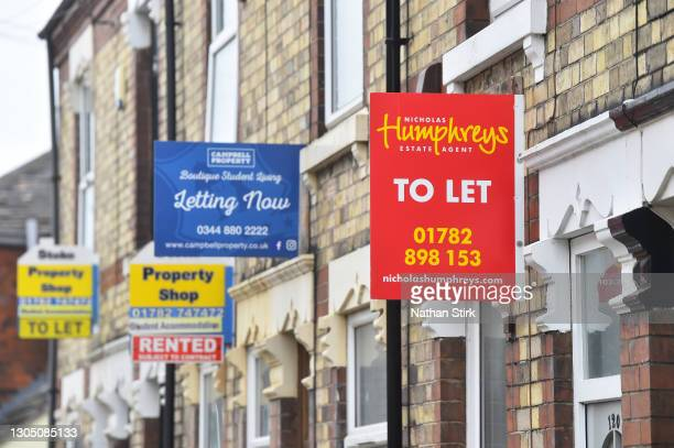 Placards from various housing estates agents advertising properties To Let and Rented on March 03, 2021 in Stoke-on-Trent, England. UK Chancellor,...