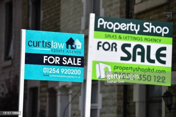 Placards from various housing estates agents advertising properties for sale on April 29, 2021 in Blackburn, England.