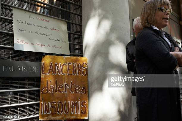 Placards in front of the Toulouse Law Court in support of Celine Boussie French whistleblower and president of the association quotHandi'gnezvousquot...