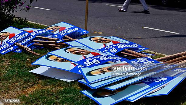 Placards in support of the Sri Lankan president lie on the ground waiting to be collected by participants in the 2013 May Day celebrations. The...