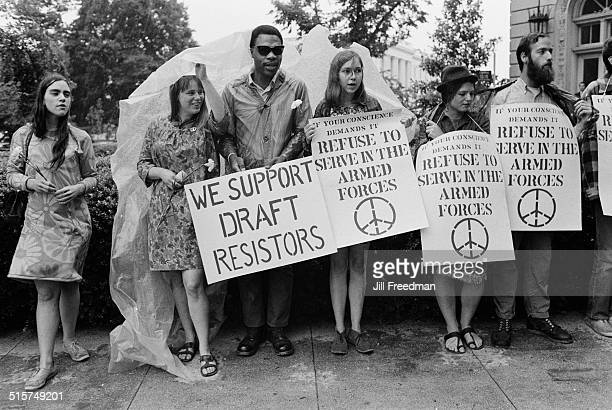 Placards in Washington DC during an antiVietnam War and antidraft protest 1968