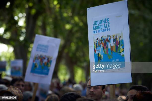 Placards reading 'World Refugee Day' Several NGOs such as Amnesty International CIMADE Cercle des Voisins etc organized a 'theatrical deambulation'...