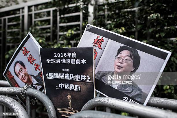 Placards showing missing bookseller Lee Bo and his associate Gui Minhai are seen left by members of the Civic party outside the China liaison office...