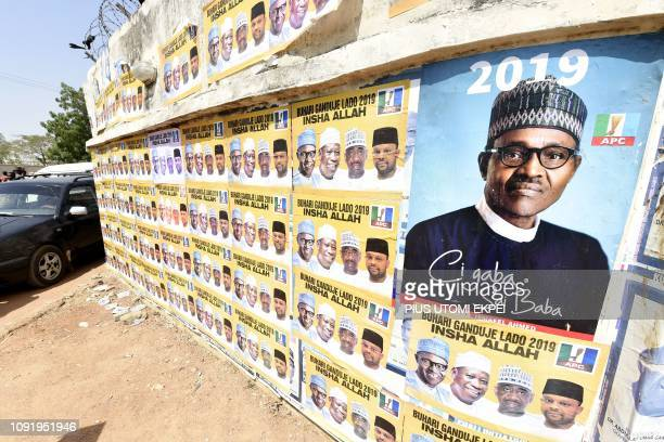 Placards with the ruling All Progressives Congress Nigerian President Mohammadu Buhari are displayed during a campaign rally at the Sanni Abacha...