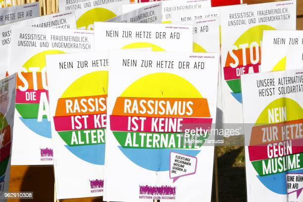 Placards with the slogan Racism is not an alternative are seen on display during a counter demo of a demonstration titled Future Germany on May 27...