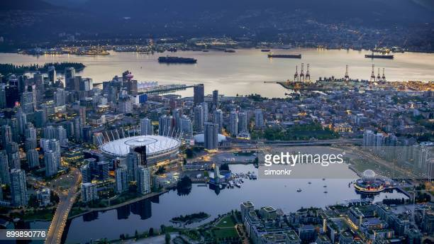 bc place and science world with cityscape - vancouver canada stock photos and pictures
