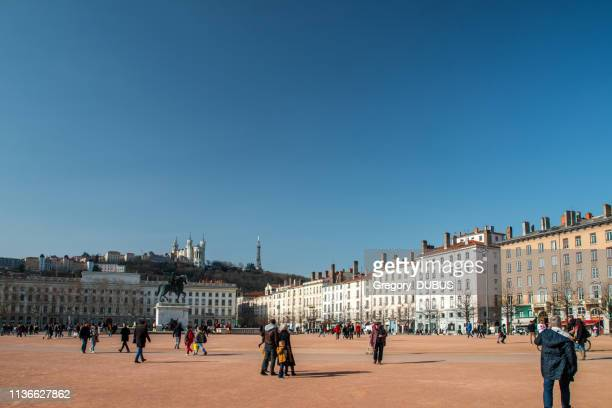 place bellecour famous town square in lyon french city in early spring season - lione foto e immagini stock