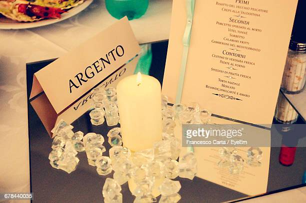 Place Card And Candles Elegantly Placed On Guest Table