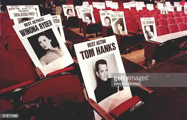 A place card for actor Tom Hanks sits along with the place cards for other movie stars 24 March in the Shrine Auditorium where the 67th Annual...