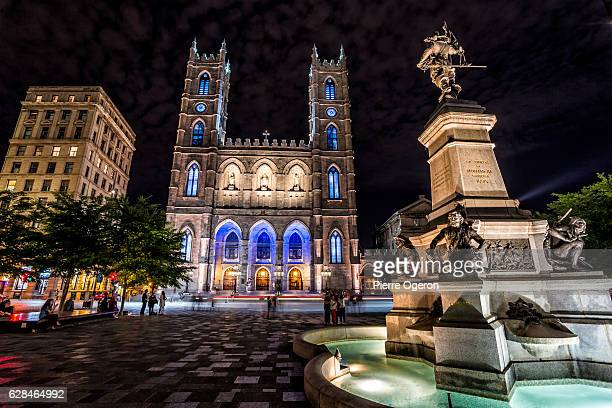 place d'armes at night - notre dame de montreal stock photos and pictures