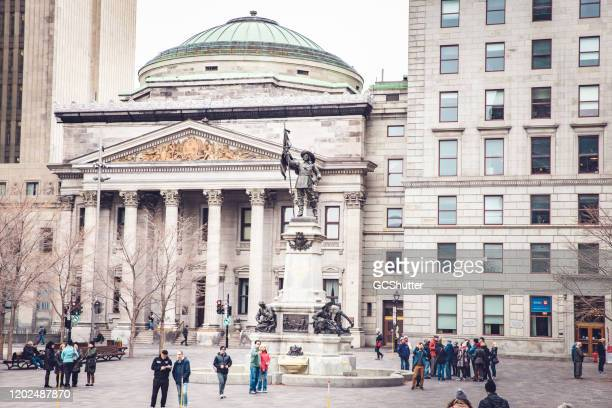 place d'armes sqaure, old montreal, quebec, canada - social history stock pictures, royalty-free photos & images