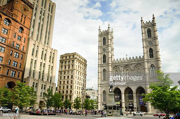 place d'armes with notre-dame basilica in montreal, quebec - notre dame de montreal stock photos and pictures