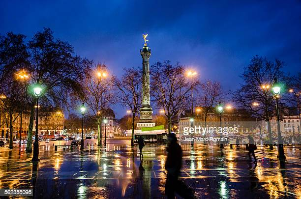 place de la bastille at night - bastille stock photos and pictures