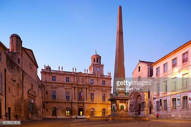 Place de la Republique with the obelisk fountain the Hotel de Ville and St. Trophime